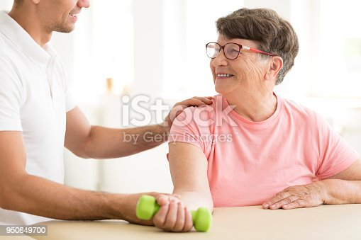 950649706istockphoto Older woman in physical rehabilitation 950649700