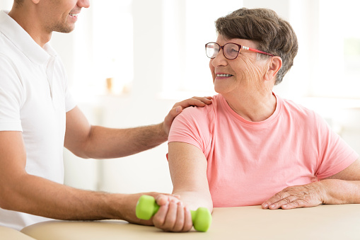 950649706 istock photo Older woman in physical rehabilitation 950649700