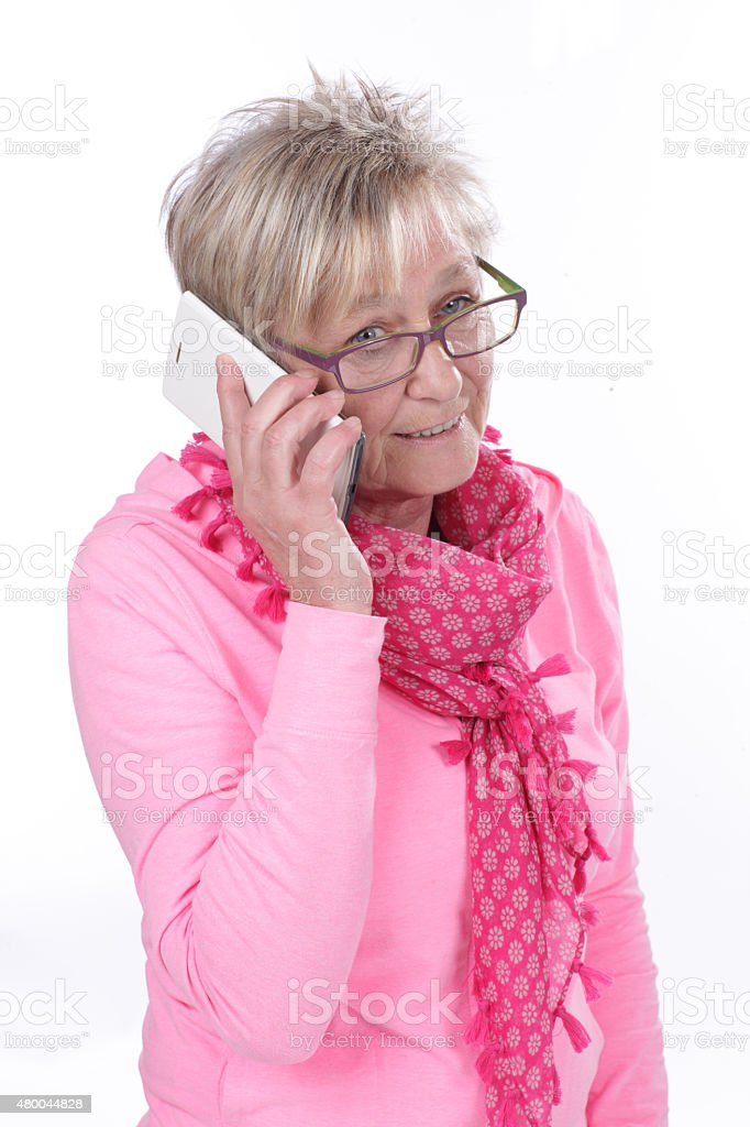 Older woman is talking on the mobile phone stock photo