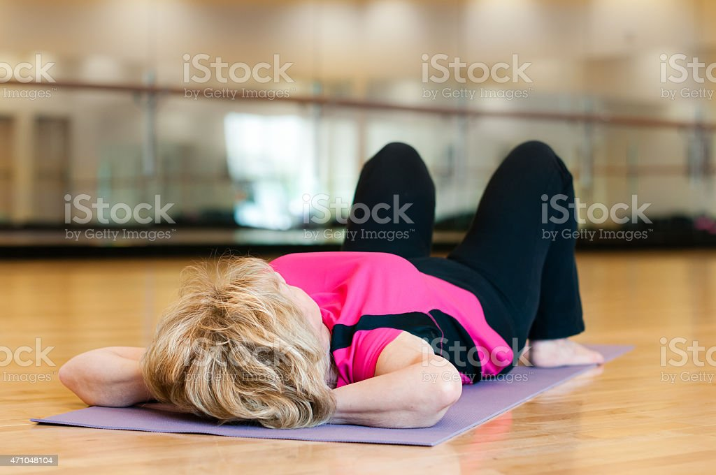 Older Woman Rests After Exercise stock photo