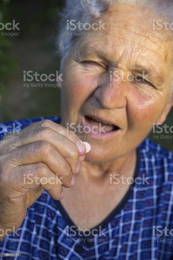 older woman taking a pills royalty-free stock photo