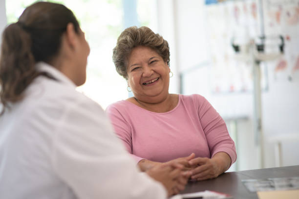 Older Woman talking with the Doctor stock photo stock photo
