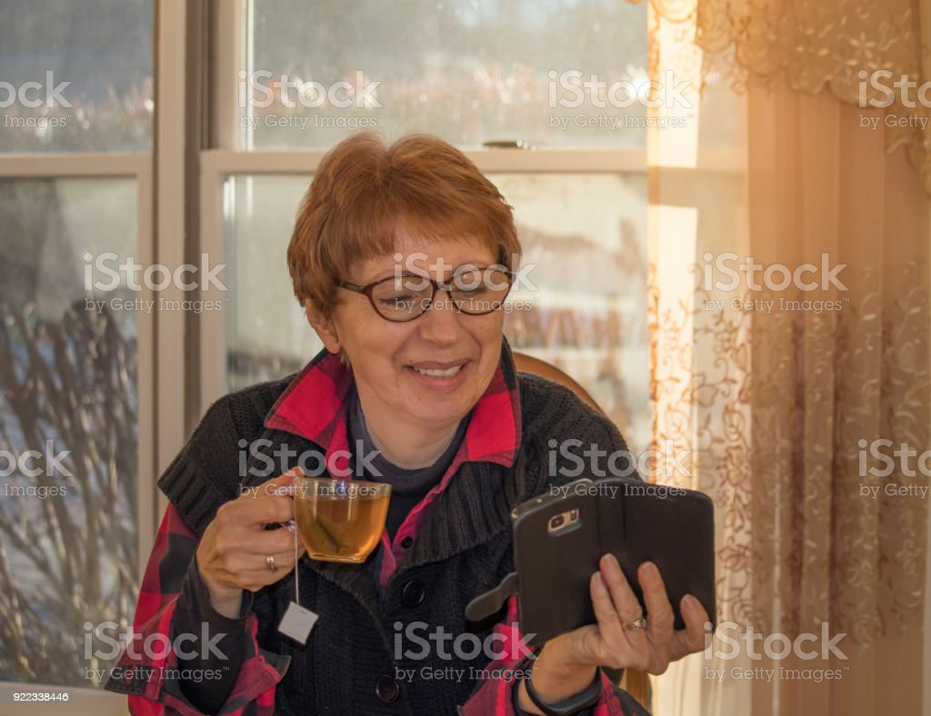 Older woman with a smart phone stock photo