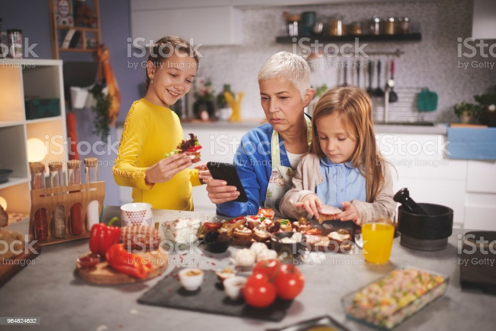 Older woman with grandchildren royalty-free stock photo