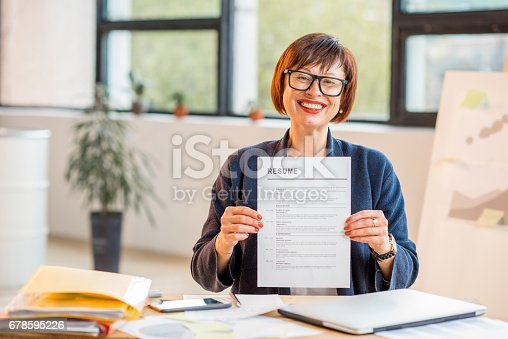 istock Older woman with resume 678595226