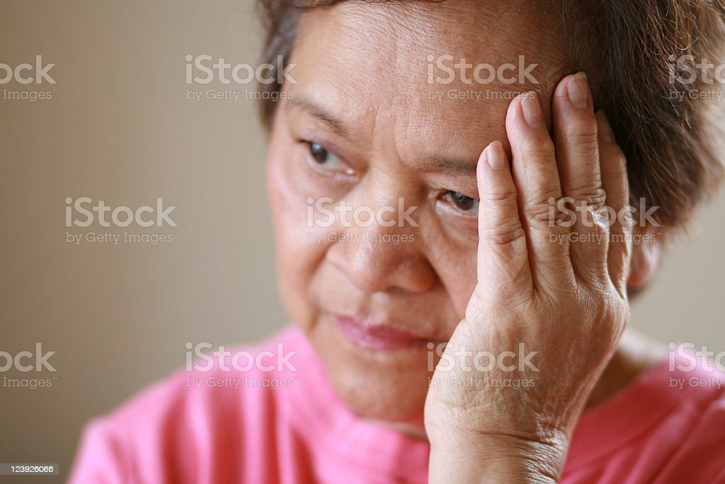 Older woman worried about the future stock photo