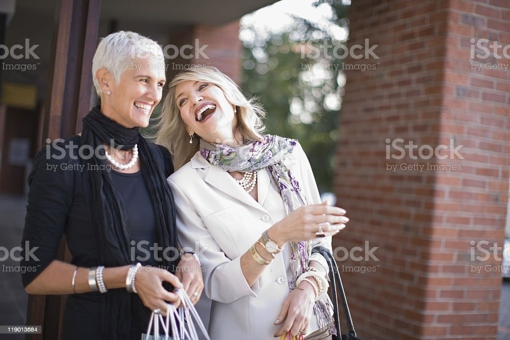 Older women carrying shopping bags stock photo