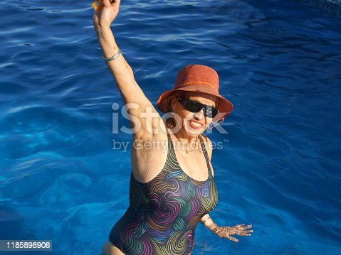 612839448 istock photo older women in the pool 1185898906