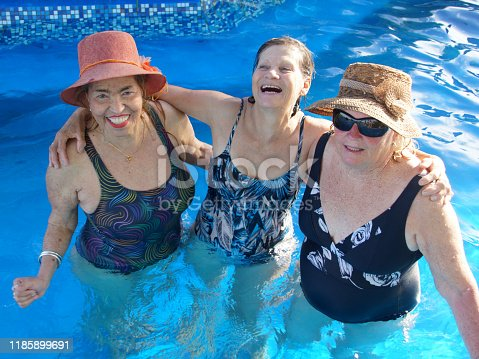 612839448 istock photo older women in the pool 1185899691