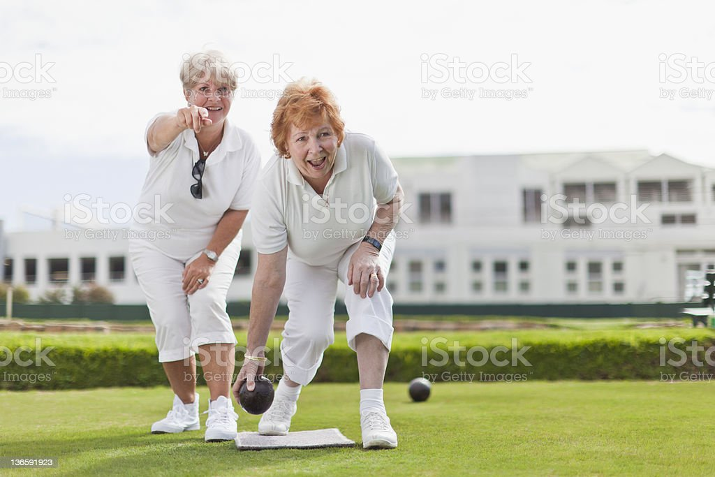 Older women playing lawn bowling stock photo