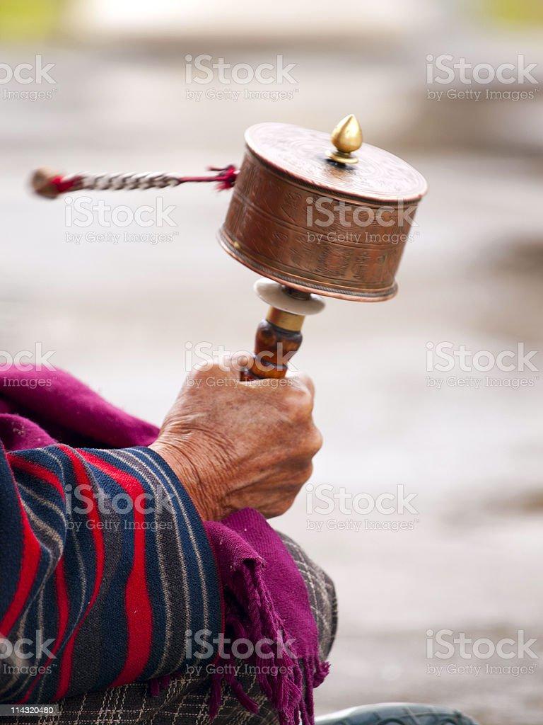 Older women spinning her prayer wheel stock photo