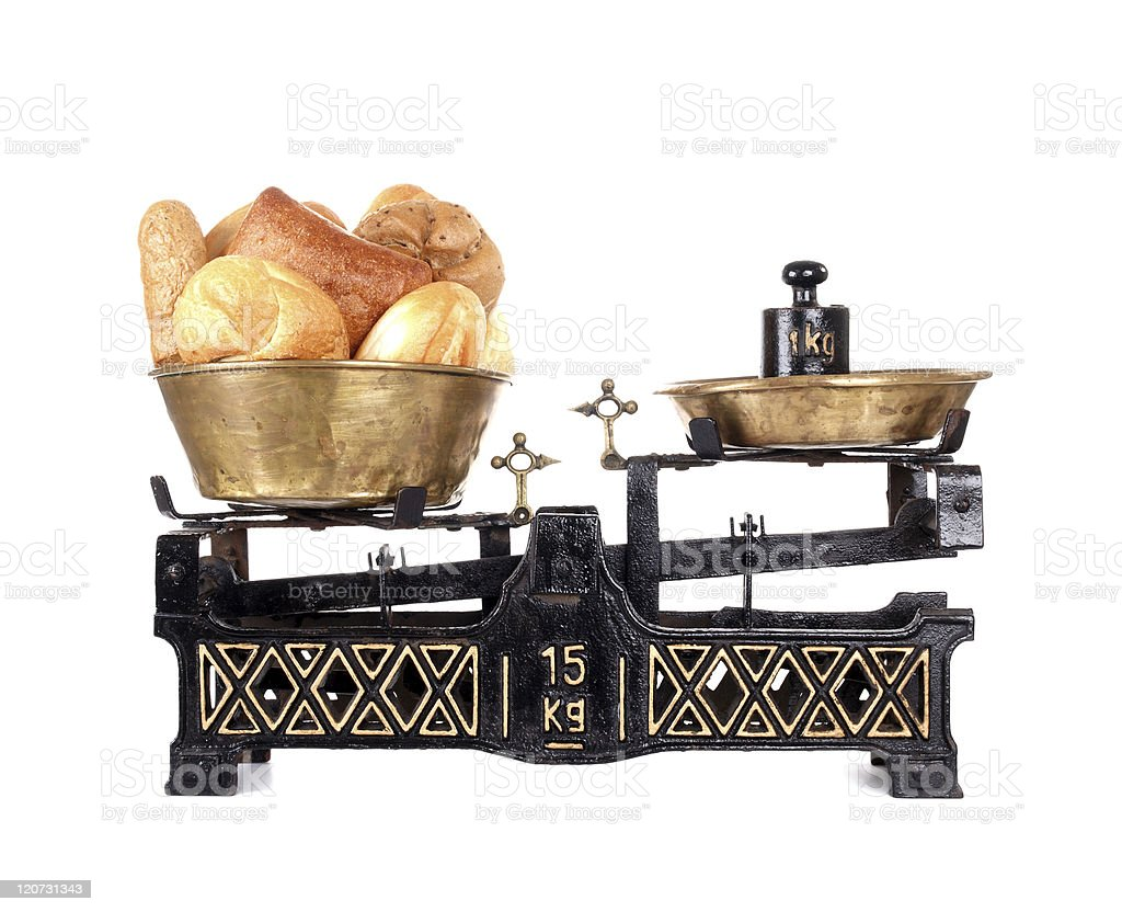 Old-fashioned balance scale with breads stock photo