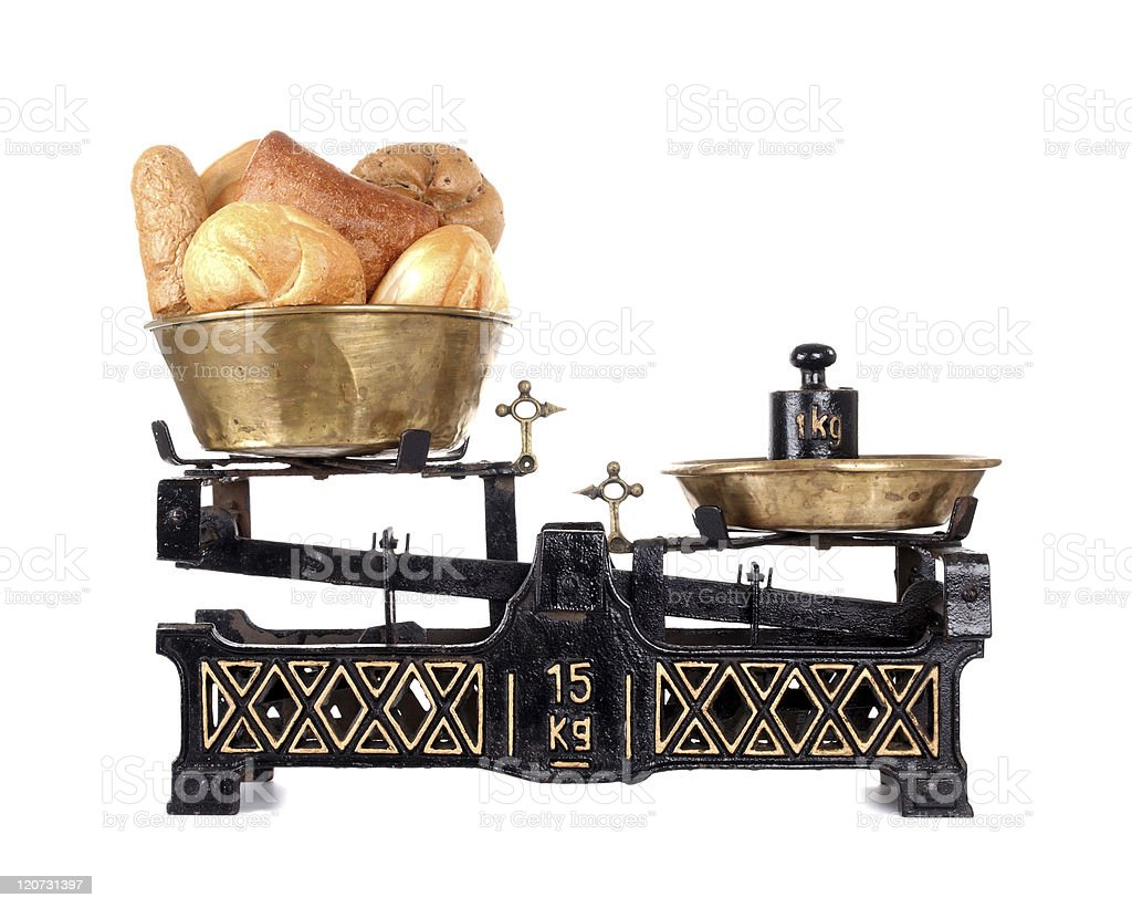 Old-fashioned balance scale with breads royalty-free stock photo