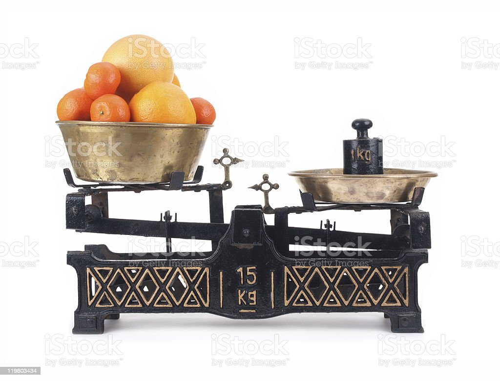Old-fashioned balance scale with citrus stock photo