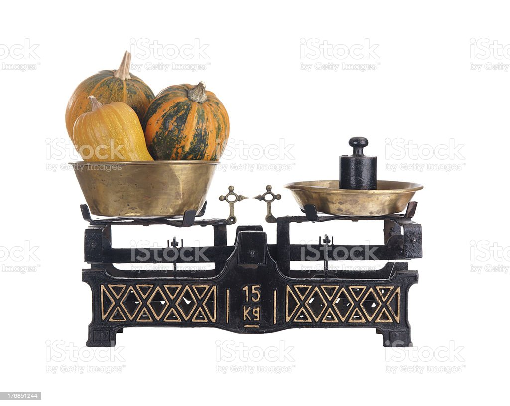 Old-fashioned balance scale with pumpkins stock photo