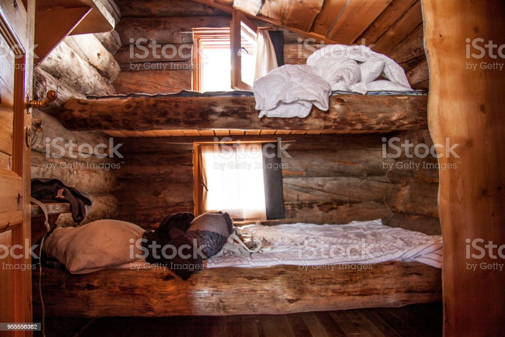 Oldfashioned Beds In A Log Cabin Stock Photo More Pictures Of Bed