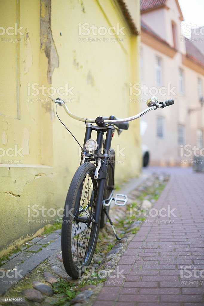 Old-fashioned bike on a street royalty-free stock photo