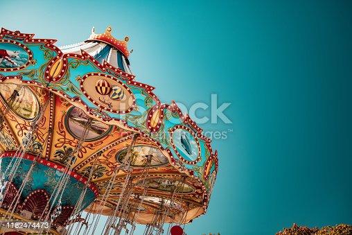 istock Old-Fashioned Chairoplane, Chain Swing Ride at Munich's Oktoberfest, Germany 1182474473