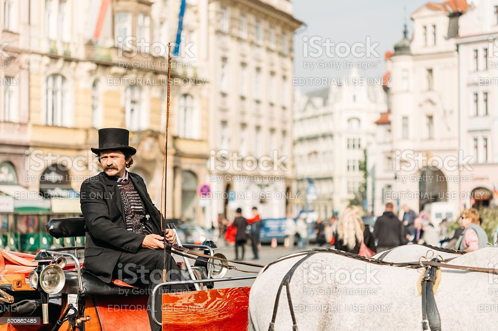 Old-fashioned Coach And Coachman At Old Town Square in Prague stock photo