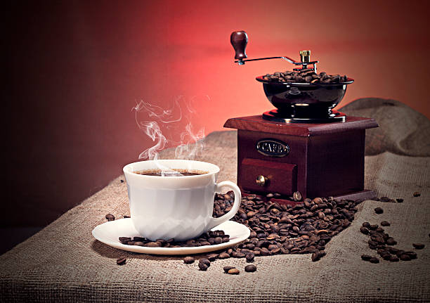Old-fashioned coffee grinder and cup stock photo