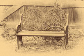 A digitally produced image of an old-fashioned, metal garden chair depicted as a calotype paper negative.