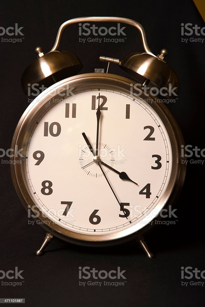 Old-fashioned iconic alarm clock - four stock photo