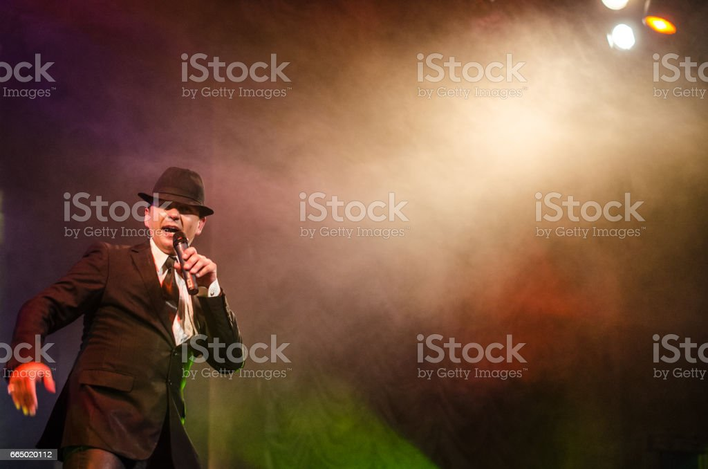 Old-fashioned man on stage looking tough stock photo