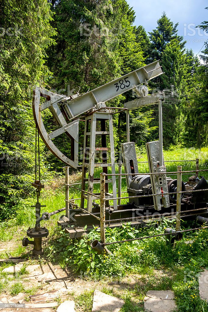 old-fashioned oil pump stock photo