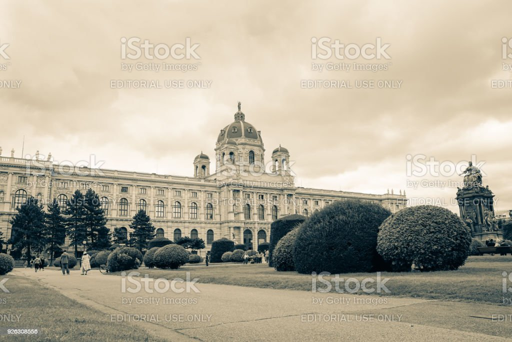 Old-fashioned photo effect of Maria Theresa Place with arts museum building, grounds, people and statue. stock photo