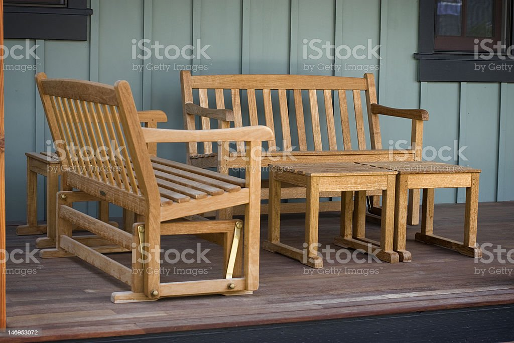 Old-Fashioned Porch with Wooden Furniture stock photo