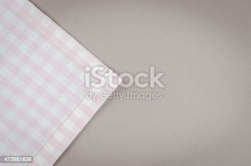 Old-fashioned tablecloth background with large brown/gray copy space for your text. Soft post-processing. Vignette. Photo made with high quality photo equipment in a modern indoor studio.