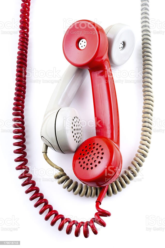 Old-fashioned telephone receivers with cord royalty-free stock photo