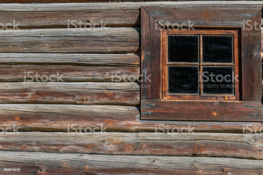 Old-fashioned window of wooden house stock photo