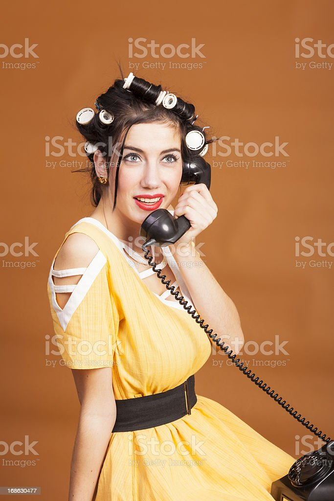 Old-fashioned woman on old telephone stock photo