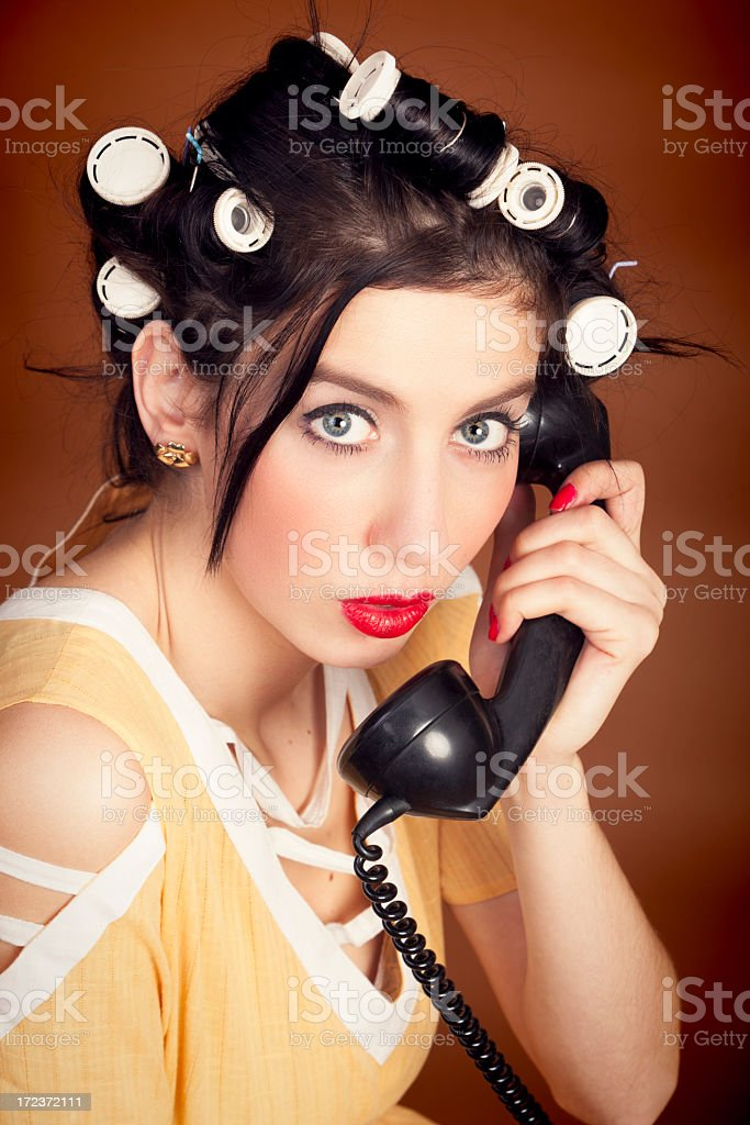 Old-fashioned woman with old telephone stock photo