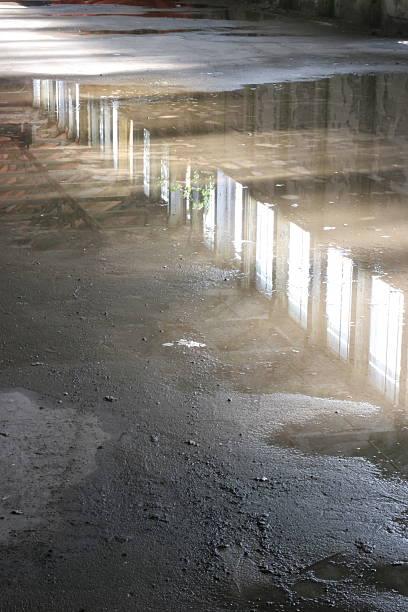 old-floor-reflecting-water1 stock photo