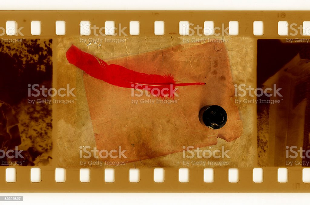 oldies 35mm frame photo with vintage page, inkwell and feather royalty-free stock photo