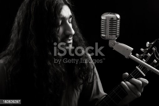 istock Oldies rocok star singing on classic microphone 182826297