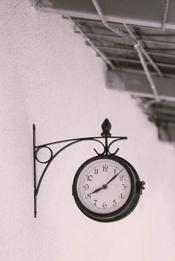 beautiful old retro watch on the outdoor wall showing eight hour