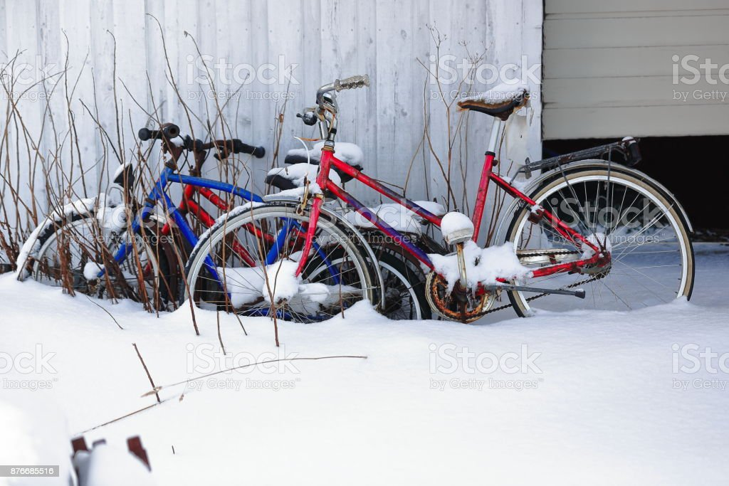 Old-rusty-abandoned bicycles leaning on the wall-fishing hut in Hovsundhamm port-Gimsoya-Lofoten-Norway.0599 stock photo