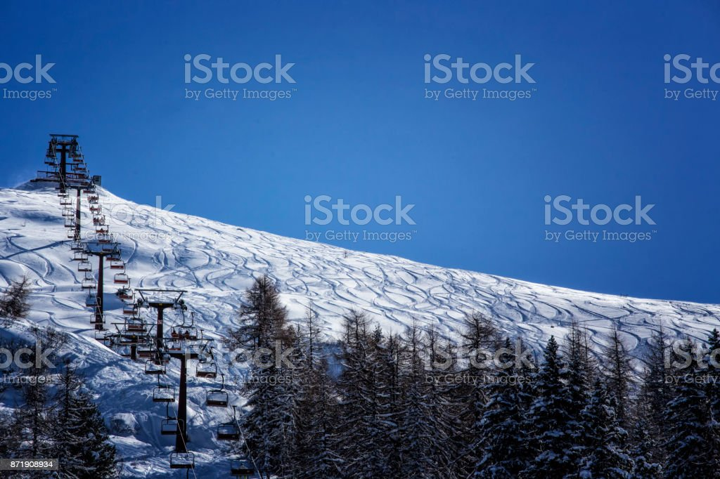 oldschool chair lift in italian dolomites, passo rolle stock photo