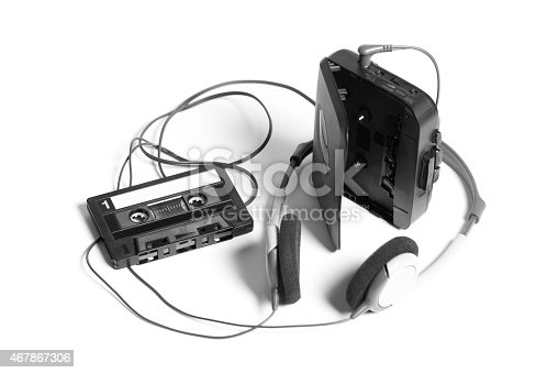 old walkman with headphones and cassette