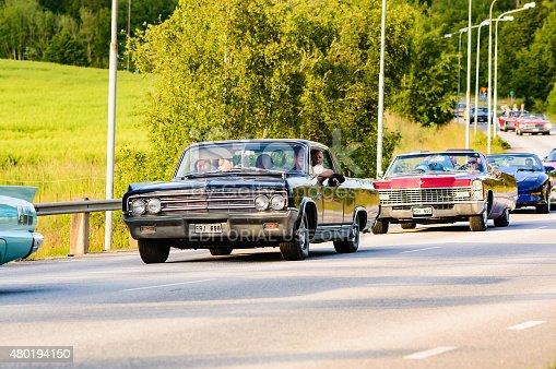 Ronneby, Sweden - June 26, 2015: Veteran car street cruise on public roads. Oldsmobile 98 1963 black in caravan.