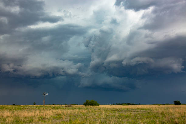 Old-style windmill dwarfed by severe, dangerous thunderstorm - Photo