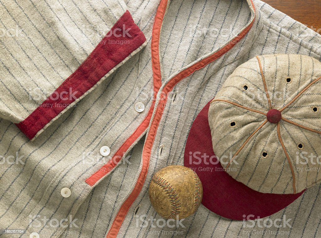 Old-time wool baseball uniform with cap and ball stock photo