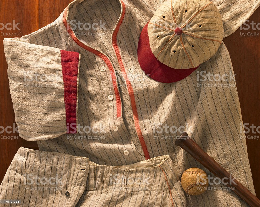 Old-time wool baseball uniform with cap, pants and bat stock photo