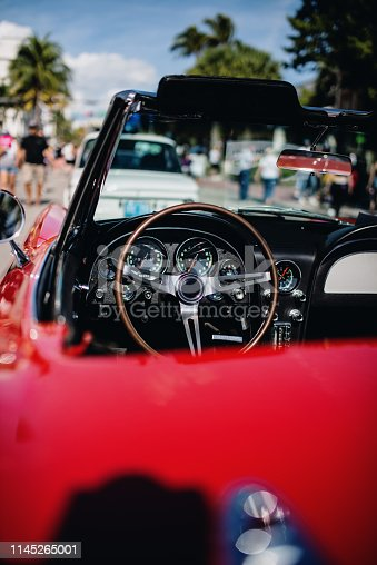 Stylish oldtimer passenger car Oldtimers were on the street in Miami, Ocean drive road, South Beach. That was night market and food festival near the beach in January 2019, cars were exhibited by owners. No entrance nor entrance fees were required for this event.
