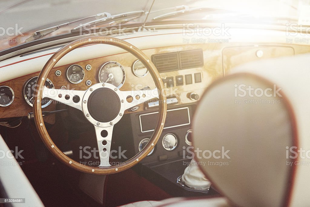 Oldtimer convertible vehicle interor with steering wheel and speedmeter stock photo