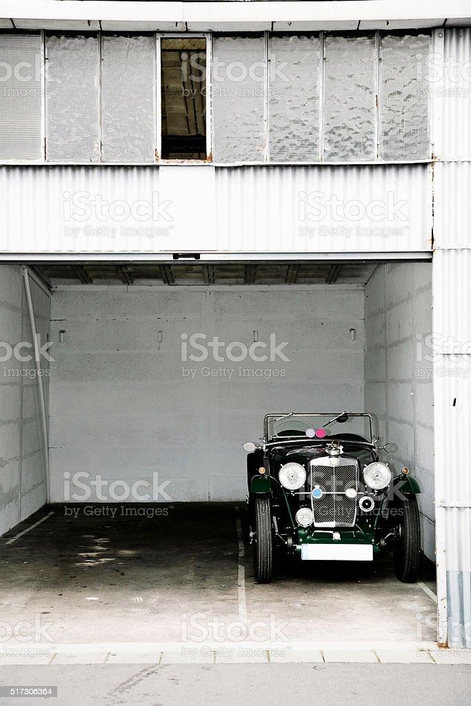 Oldtimer standing in garage stock photo
