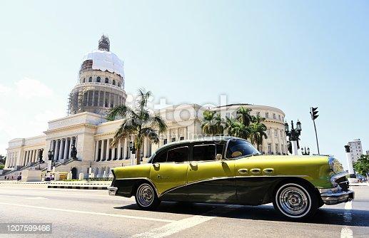 Low angle view of vintage car on street amidst buildings in Havana, Cuba